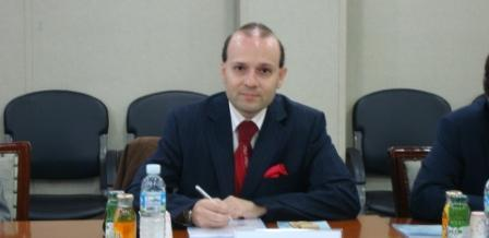 President Anton Caragea sign the document