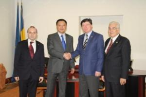 Handshake of friendship-Ambassador Daulet Batrashev and Senate Vice-President-Ioan Chelaru